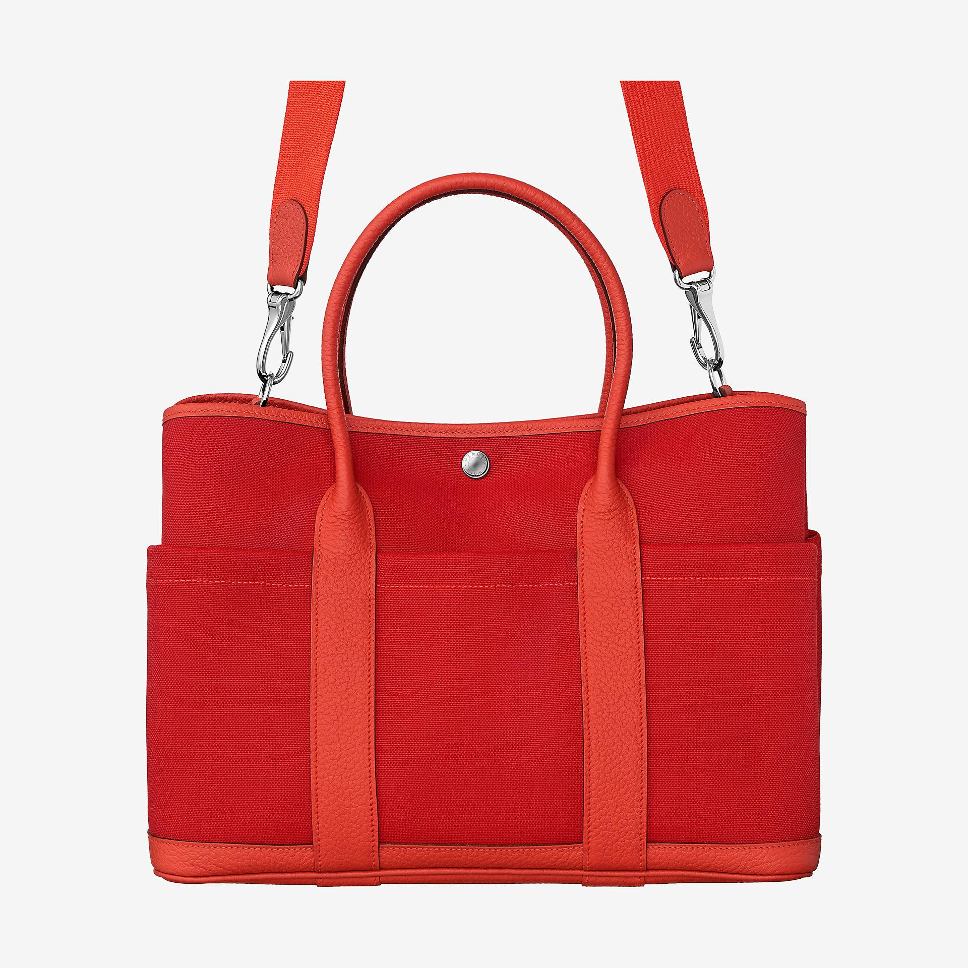 ab19a630fb05 Hermes Garden Party 36 pockets bag. Hermes bag in Country cowhide with  military canvas lining. Palladium plated Clou de Selle snap closure with  adjustable